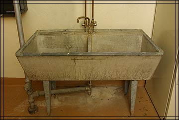Basement Utility Sink : ... laundry sink with a built-in washboard. Wet clothes were hung in a
